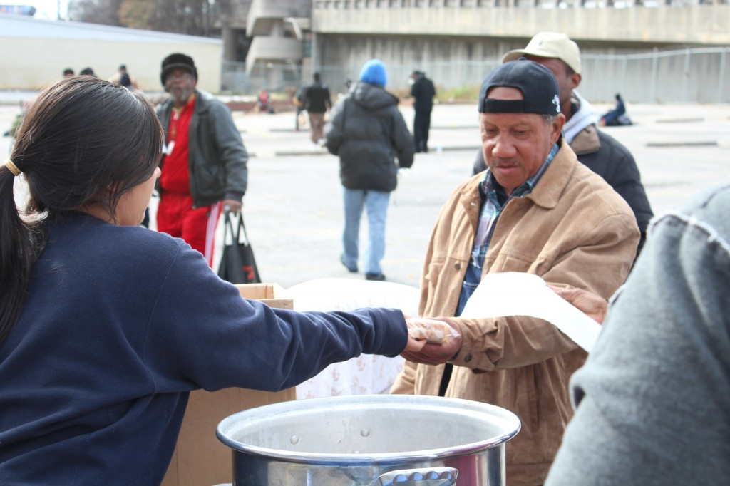 Court Ordered Community Service Volunteer Distributes Items to Homeless